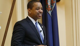"""Virginia Lt. Gov. Justin Fairfax presides over the end of the 2019 Senate session at the Capitol in Richmond, Va., Sunday, Feb. 24, 2019. Fairfax delivered an impassioned speech and said """"If we go backwards and we rush to judgment and we allow for political lynchings without any due process, any facts, any evidence being heard, then I think we do a disservice to this very body in which we all serve."""" (AP Photo/Steve Helber)"""