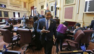"""Virginia Lt. Gov. Justin Fairfax exits the floor after the Senate adjourned their 2019 session at the Capitol in Richmond, Va., Sunday, Feb. 24, 2019. Fairfax delivered an impassioned speech and said """"If we go backwards and we rush to judgment and we allow for political lynchings without any due process, any facts, any evidence being heard, then I think we do a disservice to this very body in which we all serve."""" (AP Photo/Steve Helber)"""