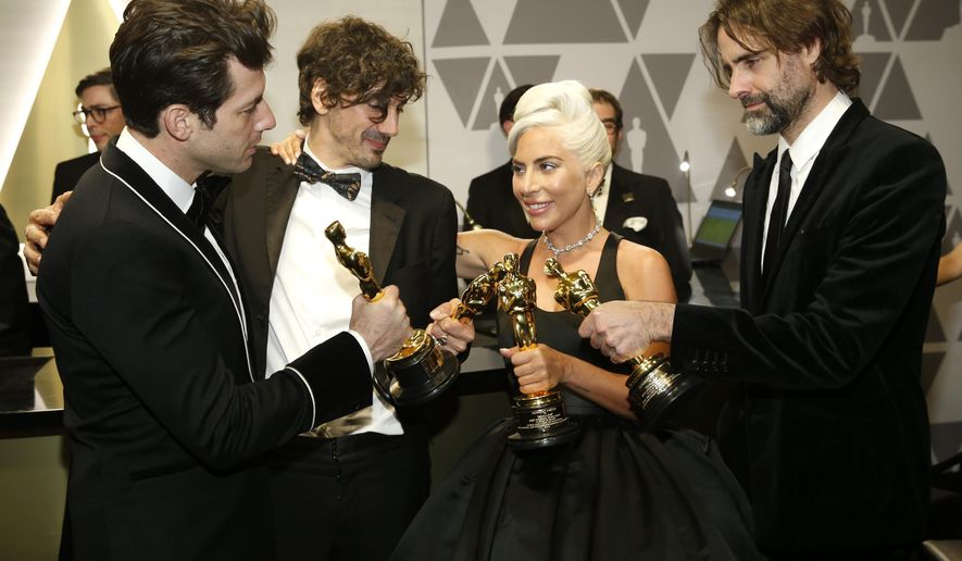 "Mark Ronson, from left, Anthony Rossomando, Lady Gaga, and Andrew Wyatt, winners of the award for best original song for ""Shallow"" from ""A Star Is Born"", attend the Governors Ball after the Oscars on Sunday, Feb. 24, 2019, at the Dolby Theatre in Los Angeles. (Photo by Eric Jamison/Invision/AP)"