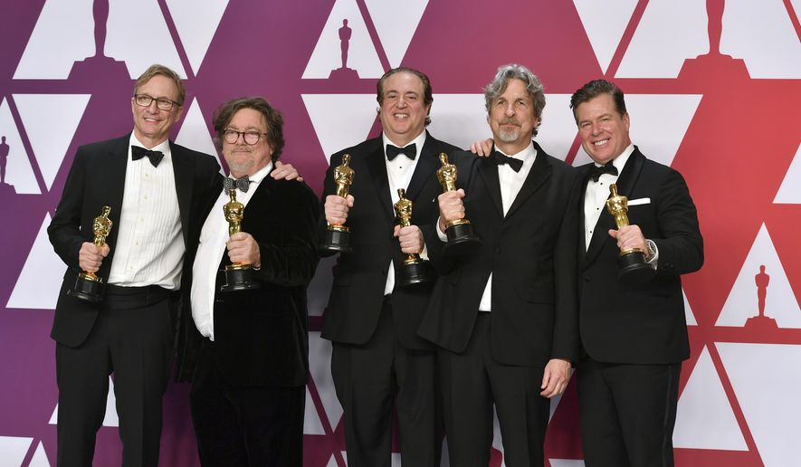 """Jim Burke, from left, Charles B. Wessler, Nick Vallelonga, Peter Farrelly, and Brian Currie pose with the award for best picture for """"Green Book"""" in the press room at the Oscars on Sunday, Feb. 24, 2019, at the Dolby Theatre in Los Angeles. (Photo by Jordan Strauss/Invision/AP)"""