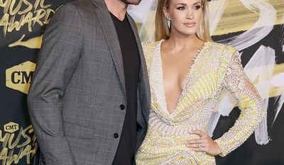 Former hockey player Mike Fisher and wife, singer Carrie Underwood