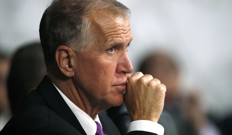 Sen. Thom Tillis, R-N.C., listens as President Donald Trump's Supreme Court nominee Brett Kavanaugh, testifies before the Senate Judiciary Committee on Capitol Hill in Washington, Wednesday, Sept. 5, 2018, on the second day of his confirmation hearing to replace retired Justice Anthony Kennedy. (AP Photo/Jacquelyn Martin)