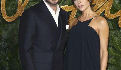 Soccer superstar David Beckham and wife, fashion designer Victoria Beckham
