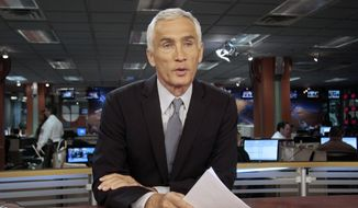 In this Dec. 14, 2011, file photo, Univision newscaster Jorge Ramos works in the studio in Miami, Florida. (AP Photo/Alan Diaz)