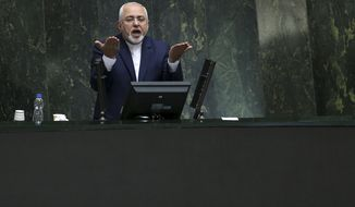 In this Oct. 7, 2018, photo, Iranian Foreign Minister Mohammad Javad Zarif speaks during an open session of parliament in Tehran, Iran. On Monday Feb. 25, 2019, Iran's state-run IRNA news agency reported that Foreign Minister Mohammad Javad Zarif has resigned. (AP Photo/Vahid Salemi) **FILE**