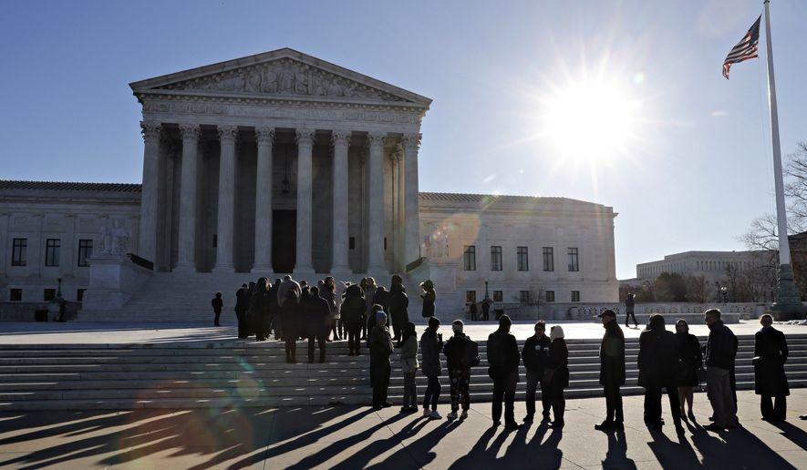 People wait to enter the Supreme Court, Monday, Feb. 25, 2019, in Washington. (AP Photo/Jacquelyn Martin)