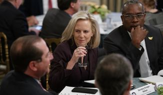 Secretary of Homeland Security Kirstjen Nielsen sits at a table before President Donald Trump arrives to speak at the 2019 White House Business Session with Our Nation's Governors in the State Dining Room of the White House in Washington, Monday, Feb. 25, 2019. (AP Photo/Carolyn Kaster) ** FILE **