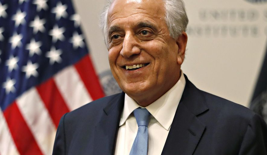 FILE - In this Feb. 8, 2019, file photo, Special Representative for Afghanistan Reconciliation Zalmay Khalilzad approaches the microphone to speak on the prospects for peace at the U.S. Institute of Peace, in Washington. Senior Taliban leaders, including one of the group's founders, have arrived in Qatar for another round of talks with Washington's special envoy tasked with finding a negotiated solution to Afghanistan's protracted war. (AP Photo/Jacquelyn Martin, File) **FILE**
