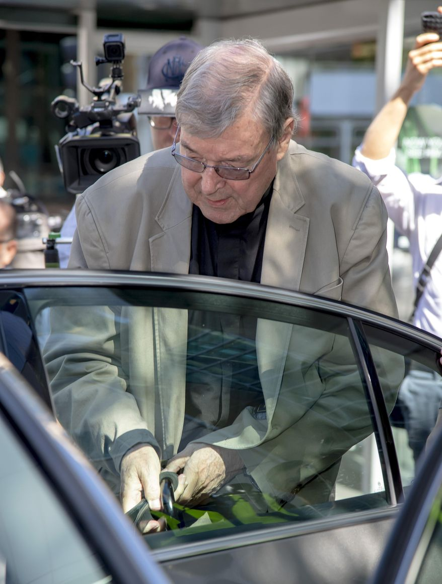 In this Friday, Feb. 22, 2019, photo, Cardinal George Pell leaves the County Court in Melbourne, Australia. The most senior Catholic cleric ever charged with child sex abuse has been convicted on Tuesday, Feb. 26, 2019 of molesting two choirboys moments after celebrating Mass, dealing a new blow to the Catholic hierarchy's credibility after a year of global revelations of abuse and cover-up. (AP Photo/Andy Brownbill)