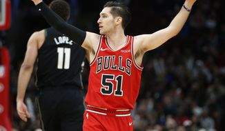 Chicago Bulls guard Ryan Arcidiacono (51) celebrates after a 3-point basket by teammate forward Lauri Markkanen against the Milwaukee Bucks during the first half of an NBA basketball game Monday, Feb. 25, 2019, in Chicago. (AP Photo/Nuccio DiNuzzo)