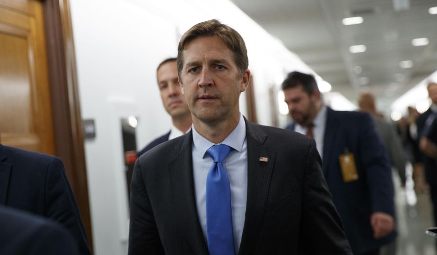In this Sept. 27, 2018, file photo, Sen. Ben Sasse, R-Neb., walks in a corridor on Capitol Hill in Washington. (AP Photo/Carolyn Kaster, File)