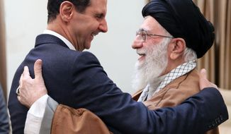 In this picture released by an official website of the office of the Iranian supreme leader, Supreme Leader Ayatollah Ali Khamenei, right, welcomes Syrian President Bashar Assad in Tehran, Iran, Monday, Feb. 25, 2019. Syrian state-run media say President Bashar Assad has visited Iran and met with officials there on a rare trip abroad. SANA said Assad met with Supreme Leader Ayatollah Ali Khamenei and President Hassan Rouhani on the trip — the first time he has traveled anywhere other than Russia since the Syrian civil war erupted nearly eight years ago.(Office of the Iranian Supreme Leader via AP)