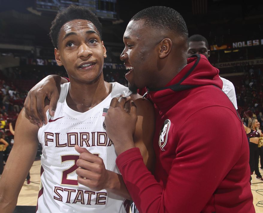 Florida State guard Devin Vassell (24) is congratulated by forward RaiQuan Gray after an NCAA college basketball game against Notre Dame in Tallahassee, Fla., Monday, Feb. 25, 2019. (AP Photo/Phil Sears)