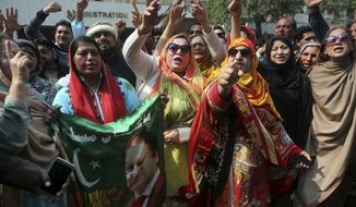 Supporters of jailed former Prime Minister of Pakistan Nawaz Sharif shouts anti-government slogans in Lahore, Pakistan, Monday, Feb. 25, 2019. A Pakistani appeals court has rejected Sharif's appeal over a seven-year prison sentence for corruption and refused to grant him release on medical grounds. (AP Photo/K.M. Chaudary)