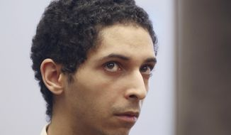 FILE - In this May 22, 2018, file photo, Tyler Barriss, of California, appears for a preliminary hearing in Wichita, Kan. The California man is asking the judge for a 20-year prison sentence for making a hoax call that led police to fatally shoot a Kansas man following a dispute between online gamers. His attorney argued in a motion Barriss never intended for anyone to get hurt and his conduct was an outgrowth of the culture within the gaming community. (Bo Rader/The Wichita Eagle via AP, File)