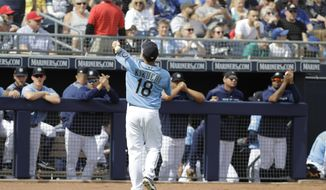 Seattle Mariners' Yusei Kikuchi tosses a baseball to fans during the first inning of a spring training baseball game against the Cincinnati Reds, Monday, Feb. 25, 2019, in Peoria, Ariz. (AP Photo/Darron Cummings)