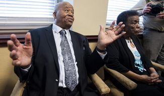 Joseph Peterson, one of the Alabama State University students that was expelled for taking part in the 1960 lunch counter sit-in in Montgomery, sits with his wife Mable Peterson as he is honored at a news conference at the ASU campus in Montgomery, Ala., on Monday, Feb. 25, 2019. (Mickey Welsh/Montgomery Advertiser via AP)