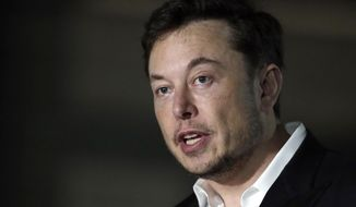 In this June 14, 2018, file photo, Tesla CEO Elon Musk speaks at a news conference in Chicago. (AP Photo/Kiichiro Sato, File)