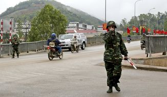 Vietnamese soldiers guard a road near Dong Dang train station where North Korean leader Kim Jong Un is expected to arrive at the border town with China, in Dong Dang, Lang Son province, Vietnam, Monday, Feb. 25, 2019. The second summit between U.S. President Donald Trump and North Korean leader Kim Jong Un will take place in Hanoi on Feb. 27 and 28. (AP Photo/Minh Hoang)