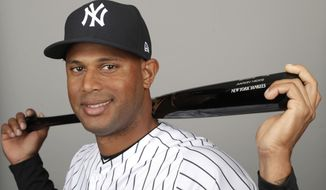 FILE - This is a 2019 file photo showing Aaron Hicks of the New York Yankees baseball team. A person familiar with the negotiations tells The Associated Press that outfielder Aaron Hicks and the New York Yankees have agreed to a $70 million, seven-year contract that adds $64 million in guaranteed money over six seasons. Hicks' agreement includes a club option for 2026 that could make it worth $81.5 million over seven seasons, the person said Monday, Feb. 25, 2019. The person spoke on condition of anonymity because the agreement had not yet been announced.  (AP Photo/Lynne Sladky, File)
