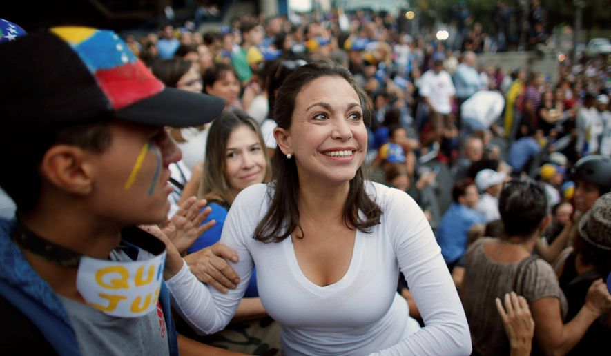 Opposition leader Maria Corina Machado, is in the thick of fighting against a former lawmaker, greets supporters during a vigil in honor of those who have been killed during clashes between security forces and demonstrators in Caracas, Venezuela, Monday, July 31, 2017. Many analysts believe Sunday's vote for a newly elected assembly that will rewrite Venezuelas constitution will catalyze yet more disturbances in a country that has seen four months of street protests in which at least 125 people have died. (AP Photo/Ariana Cubillos) (Associated Press)