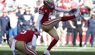 FILE - In this Dec. 23, 2018, file photo, San Francisco 49ers kicker Robbie Gould (9) kicks a field goal from the hold of Bradley Pinion during the first half of an NFL football game against the Chicago Bears, in Santa Clara, Calif. The S49ers have placed the franchise tag on kicker Robbie Gould. The Niners made the move Tuesday, Feb. 26, 2019, to keep Gould in 2019 for a price tag of about $5 million. (AP Photo/Tony Avelar, File)