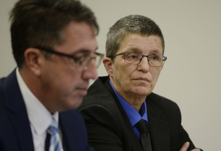 FILE- In a Dec. 11, 2018 file photo, Nikki Joly appears for a preliminary examination in Jackson County District Court in Jackson, Mich. Joly is charged with first degree arson stemming from a Aug. 10, 2017 fire at Joly's home. Michigan police say the transgender, gay rights activist tried to fabricate a hate crime by setting his home on fire, but the man's attorney is questioning the evidence. Attorney Daniel Barnett said the evidence is circumstantial and doesn't provide proof beyond a reasonable doubt that Joly set the August 2017 fire that killed five pets at his home in Jackson. (J. Scott Park/Jackson Citizen Patriot via AP)