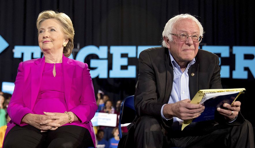In this Nov. 3, 2016, file photo, Democratic presidential candidate Hillary Clinton and Sen. Bernie Sanders, D-Vt., appear at a rally at Coastal Credit Union Music Park at Walnut Creek in Raleigh, N.C. The tension between supporters of Bernie Sanders and Hillary Clinton resurfaced on Tuesday after the Vermont senator announced his second run for the White House. (AP Photo/Andrew Harnik) ** FILE **