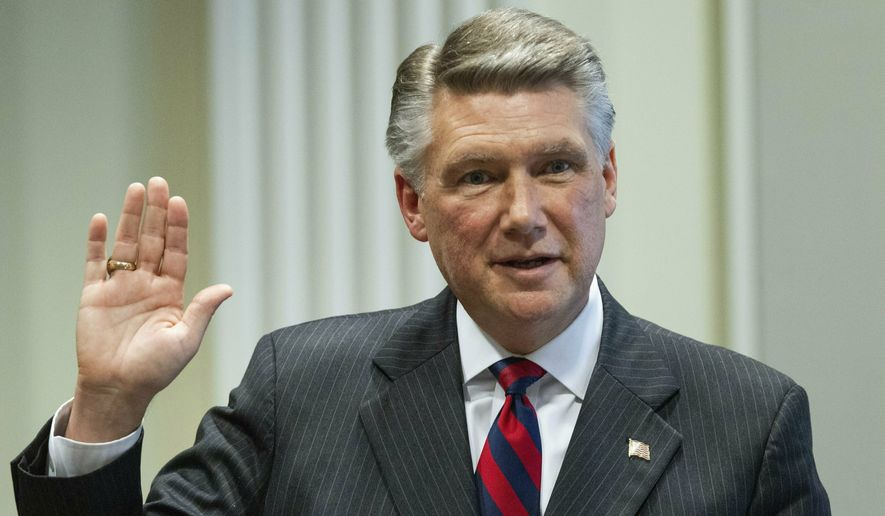 FILE - In this Thursday, Feb. 21, 2019, file photo, Mark Harris, Republican candidate in North Carolina's 9th Congressional race, prepares to testify during the fourth day of a public evidentiary hearing on the 9th Congressional District voting irregularities investigation at the North Carolina State Bar in Raleigh, N.C. Harris, whose narrow lead in the North Carolina congressional race was thrown out because of suspicions of ballot fraud, announced Tuesday, Feb. 26, 2019, he will not run in the newly ordered do-over election, saying he needs surgery in late March. (Travis Long/The News & Observer via AP, Pool, File)