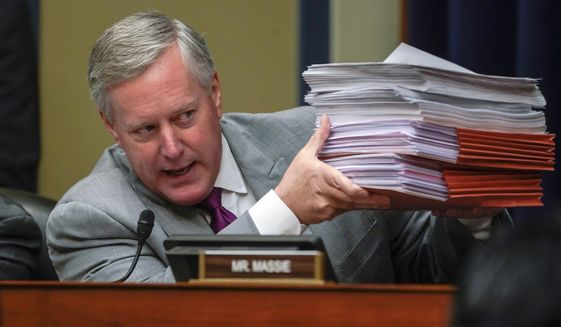 Rep. Mark Meadows, R-N.C., objects to House Oversight and Reform Committee Chair Elijah Cummings, D-Md., efforts to subpoena Trump administration officials over family separations at the southern border, on Capitol Hill in Washington, Tuesday, Feb. 26, 2019. The committee voted to subpoena Trump administration officials over family separations at the southern border, the first issued in the new Congress as Democrats have promised to hold the administration aggressively to count.  The decision by the Oversight Committee will compel the heads of Justice, Homeland Security and Health and Human Services to deliver documents.  (AP Photo/J. Scott Applewhite)