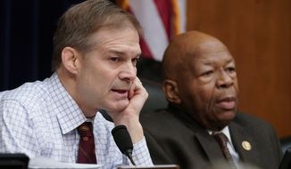 Rep. Jim Jordan of Ohio, the House Oversight and Reform Committee ranking Republican, left, and Chairman Elijah Cummings, D-Md., right, during a committee hearing on Capitol Hill in Washington, Tuesday, Feb. 26, 2019. The committee voted to subpoena Trump administration officials over family separations at the southern border, the first issued in the new Congress as Democrats have promised to hold the administration aggressively to count.  The decision by the Oversight Committee will compel the heads of Justice, Homeland Security and Health and Human Services to deliver documents. (AP Photo/J. Scott Applewhite)