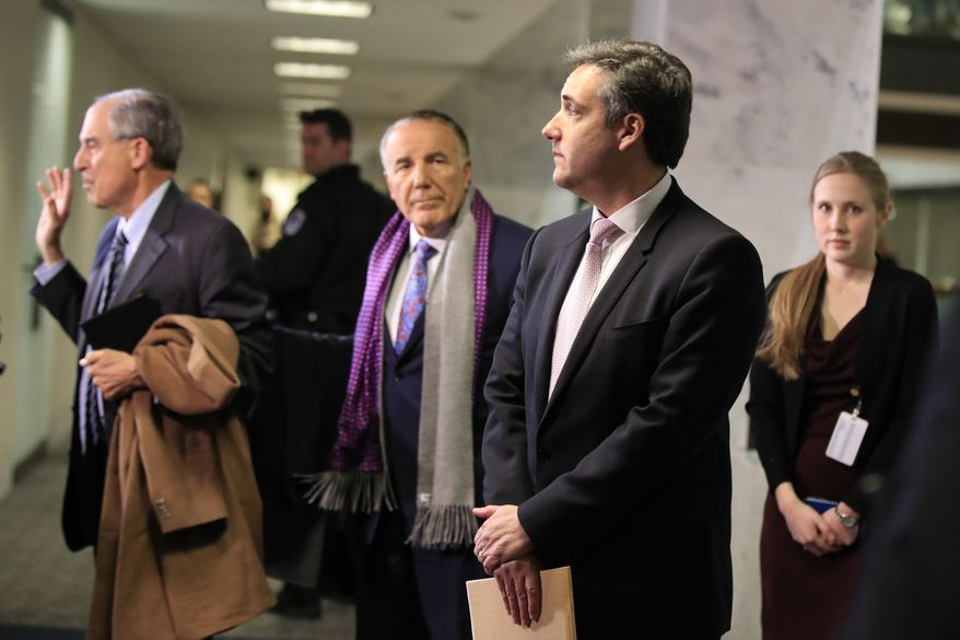 Michael Cohen, President Donald Trump's former lawyer, second from right, leaves after a closed door Senate Intelligence Committee hearing on Capitol Hill in Washington, Tuesday, Feb. 26, 2019. (AP Photo/Manuel Balce Ceneta)