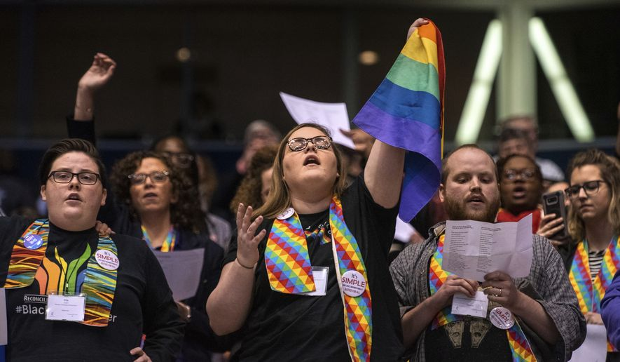 In this file photo, Shelby Ruch-Teegarden, center, of Garrett-Evangelical Theological Seminary joins other protestors during the United Methodist Church's special session of the general conference in St. Louis, Tuesday, Feb. 26, 2019. America's second-largest Protestant denomination has canceled its 2020 general conference due to the coronavirus emergency. The denomination was supposed to deliberate on a plan to split in two denominations in light of irreconcilable theological differences related to sexual ethics. (AP Photo/Sid Hastings) **FILE**