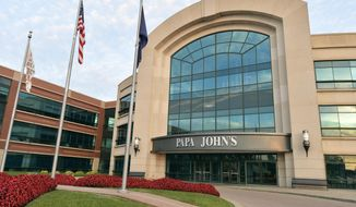 FILE - This Tuesday, July 17, 2018, file photo, shows the corporate headquarters of Papa John's Pizza, located on their corporate campus, in Louisville, Ky. Papa John's closed out a tough year on a weak note but says it expects improvement in 2019. (AP Photo/Timothy D. Easley, File)