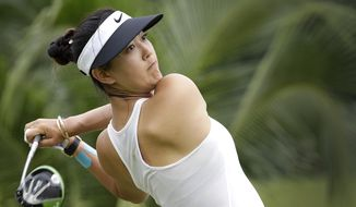 FILE - In this March 4, 2017, file photo, Michelle Wie of the United States tees off on the 2nd hole during the HSBC Women's Champions golf tournament at Sentosa Golf Club's Tanjong course in Singapore. The LPGA Tour completes its four-week swing through Australia and Asia with a healthy Wie defending her title at the 2019 HSBC Women's World Championship at the course. (AP Photo/Wong Maye-E) ** FILE **