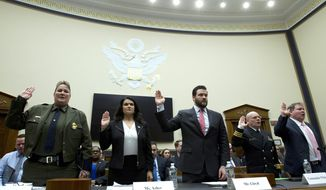 From left, U.S. Border Patrol, Customs and Border Protection Chief Carla Provost, Acting Executive Associate Director on Immigration and Customs Enforcement Operations Nathalie R. Asher, Senior Adviser Department of Health and Human Services Scott Lloyd, U.S. Public Health Service Commissioned Corps Commander Jonathan White and Department of Justice Director of Executive Office for Immigration Review James McHenry are sworn-in before the House Judiciary Committee hearing on the Trump administration's separation policy involving migrant families. on Capitol Hill in Washington, Tuesday, Feb. 26, 2019. (AP Photo/Jose Luis Magana)
