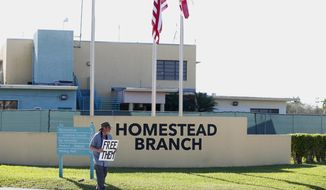 In this Feb. 19, 2019, photo, Josh Rubin demonstrates in front of the Homestead Temporary Shelter for Unaccompanied Children in Homestead, Fla. House Democrats are laying the groundwork to subpoena Trump administration officials over family separations at the southern border. (AP Photo/Wilfredo Lee)