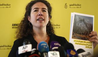 "Heba Morayef, Amnesty International's Middle East Regional Director, holds a report at a press conference, in Beirut, Lebanon, Tuesday, Feb. 26, 2019. Amnesty International says the world community's ""chilling complacency toward wide-scale human rights violations"" in the Middle and North Africa emboldened governments to commit ""appalling"" violations last year. The group's annual survey of the human rights situation in the region, released in Beirut on Tuesday, says ongoing crackdowns on dissent and civil society ""intensified significantly"" in Egypt, Iran and Saudi Arabia. (AP Photo/Hussein Malla)"