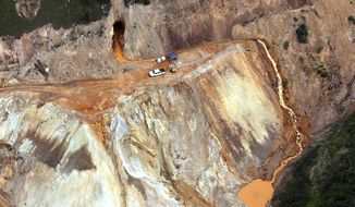 File - In this Aug. 11, 2015, file photo, wastewater streams from the Gold King Mine in southwestern Colorado. The spill was inadvertently triggered by the Environmental Protection Agency, which later created a Superfund district that includes the Gold King and nearly 50 other mining sites in the area. On Monday, Feb. 25, 2019, Sunnyside Gold Corp. said the EPA is mismanaging the cleanup and should be removed as the agency in charge. Sunnyside owns mining property in the Superfund district and has been targeted by the EPA to help pay for the cleanup. (Geoff Liesik/The Deseret News via AP, File)