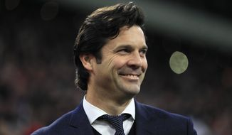Real coach Santiago Solari smiles as he stands on the touchline before the first leg, round of sixteen, Champions League soccer match between Ajax and Real Madrid at the Johan Cruyff ArenA in Amsterdam, Netherlands, Wednesday Feb. 13, 2019. (AP Photo/Peter Dejong)