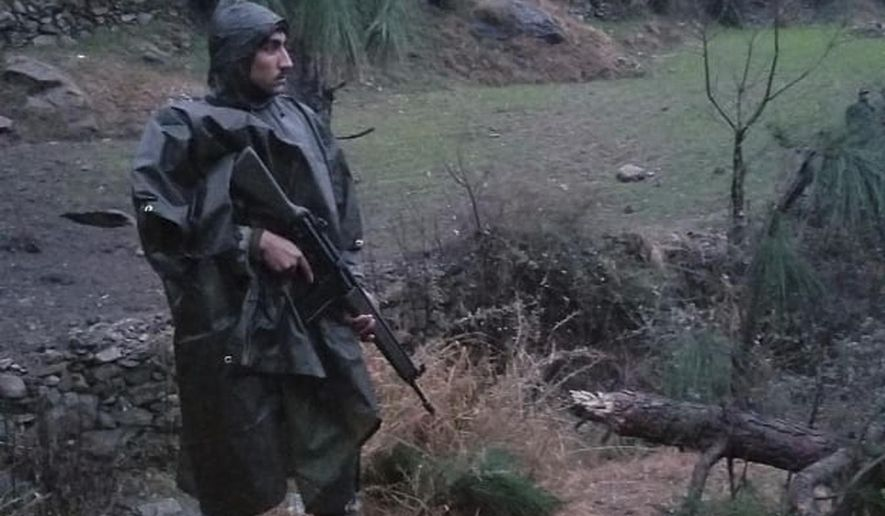 """A Pakistani soldier stands guard in the area where Indian jets strike in Jaba near Balakot, in Pakistan, Tuesday, Feb. 26, 2019. Pakistan said India launched an airstrike on its territory early Tuesday that caused no casualties, while India said it targeted a terrorist training camp in a pre-emptive strike that killed a """"very large number"""" of militants. (AP Photo/Riaz Khan)"""