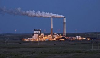 FILE - In this May 25, 2017, file photo, the Milton R. Young Station lignite coal-fired power plant near Center, N.D., glows as dusk blankets the North Dakota prairie landscape. The U.S. Environmental Protection Agency announced Tuesday, Feb. 26, 2019, it will retain the standard for sulfur dioxide pollution established in 2010 under President Barack Obama. Sulfur dioxide comes from burning coal to produce electricity and from other industrial sources. (Tom Stromme/The Bismarck Tribune via AP, File)