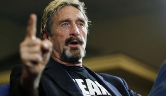 In this Sept. 9, 2015 file photo, internet security pioneer John McAfee announces his candidacy for president in Opelika, Ala. McAfee became involved with a defunct operation called the Round House started by Kyle Sandler in Opelika. He briefly ran for president with the business incubator as his headquarters and Sandler as an adviser in 2016. Sandler has since pleaded guilty to federal charges in an investment scam that involved the Round House. (Todd J. Van Emst/Opelika-Auburn News via AP, File)