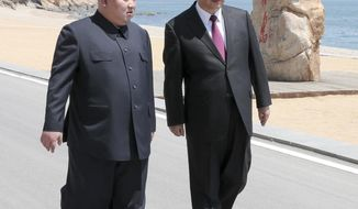 FILE - In this May 7, 2018, file photo released by Xinhua News Agency, Chinese President Xi Jinping, right, walks with North Korean leader Kim Jong Un during a meeting in Dalian in northeastern China's Liaoning Province. For China, concerns about instability in North Korea, its ostensible communist ally, have long overridden worries about its nuclear arsenal. Beijing chiefly fears a collapse of the North Korean economy that could lead to armed conflict within the government and a potential flood of refugees streaming across the rivers that separate the neighbors. (Ju Peng/Xinhua via AP, File)