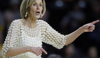 Connecticut associate head coach Chris Dailey directs her team during the second half of an NCAA college basketball game against Wichita State in Wichita, Kan., Tuesday, Feb. 26, 2019. UConn won 84-47. (AP Photo/Orlin Wagner)