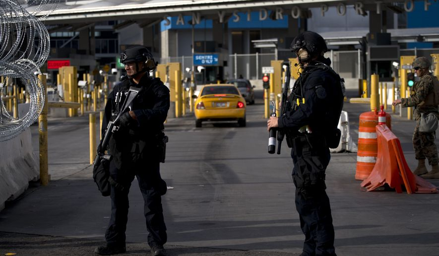 "U.S. Customs and Border Protection agents attend operational readiness exercises at the San Ysidro port of entry on the U.S.-Mexico border, seen from Tijuana, Mexico, Thursday, Nov. 22, 2018. U.S. President Donald Trump threatened Thursday to close the U.S. border with Mexico for an undisclosed period if his administration determines Mexico has lost ""control"" on its side. (AP Photo/Ramon Espinosa)"
