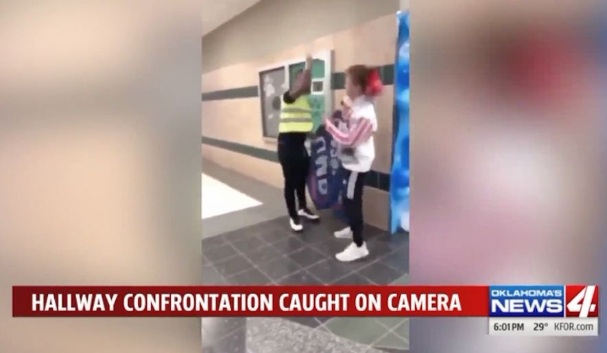 "A student at Edmond Santa Fe High School in Oklahoma is facing a potential criminal charge after video showed him knocking a ""Make America Great Again"" hat off another student's head. (KFOR-TV)"