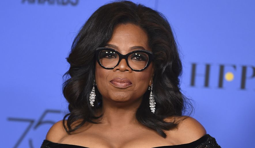 Oprah Winfrey poses in the press room with the Cecil B. DeMille Award at the 75th annual Golden Globe Awards in Beverly Hills, California, Jan. 7, 2018. (Photo by Jordan Strauss/Invision/AP) ** FILE **