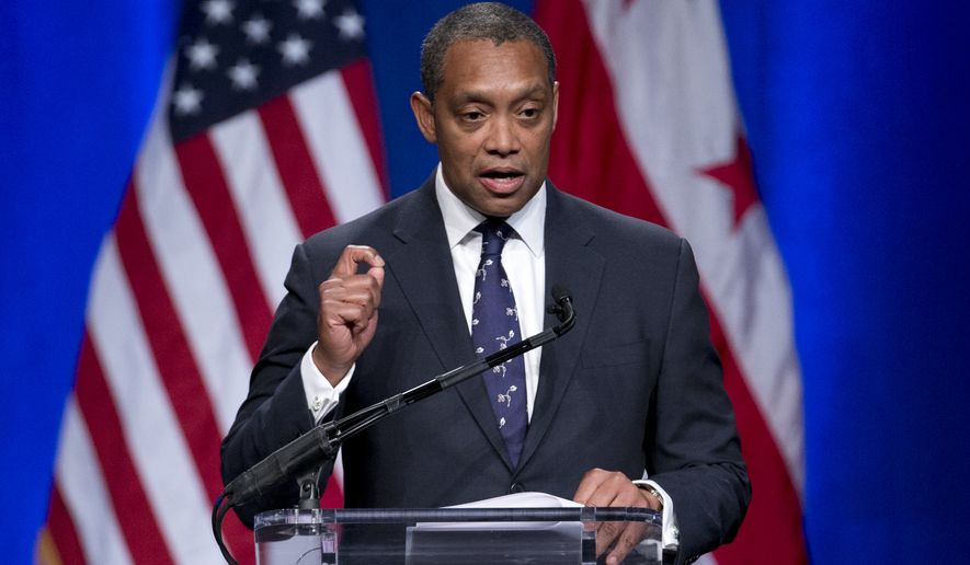 In this Jan. 2, 2015 photo, Attorney General of the District of Columbia Karl Racine speaks during the 2015 District of Columbia Inauguration ceremony at the Convention Center in Washington. On Wednesday, Feb. 27, 2019, a spokesman for President Donald Trump's inaugural committee has confirmed that Racine's office has subpoenaed financial records from the committee regarding the $107 million the committee raised to hold inaugural events. (AP Photo/Carolyn Kaster)