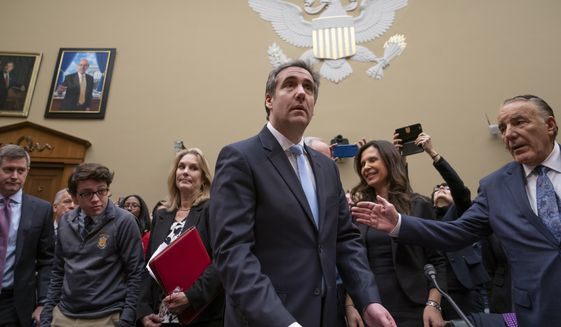 Michael Cohen, President Donald Trump's former personal lawyer, arrives to testify before the House Oversight and Reform Committee on Capitol Hill in Washington, Wednesday, Feb. 27, 2019.  (AP Photo/J. Scott Applewhite)